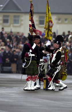 HRH The Prince Charles presents the Regimental Colour